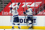 Tampa Bay Lightning center Blake Coleman (20) celebrates his goal with Tyler Johnson during overtime of an NHL hockey game against the Detroit Red Wings Tuesday, March 9, 2021, in Detroit. Tampa Bay won 4-3. (AP Photo/Paul Sancya)