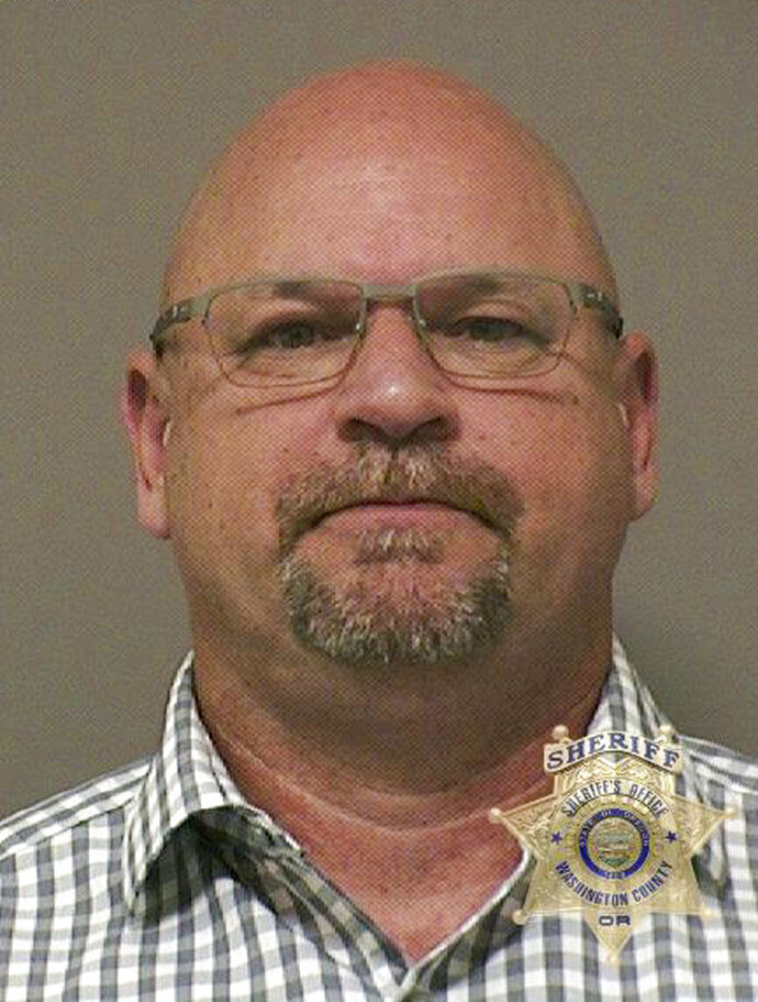 This undated photo provided by the Washington County Sheriff's office shows Scott Taube. Taube, a Washington state fire captain, is accused of groping a woman during a training exercise in Oregon. The Washington County Sheriff's Office in Oregon says 52-year-old Taube was charged Tuesday, Sept. 11, 2018,  with third-degree sexual abuse and harassment. (Washington County Sheriff's Office via AP)