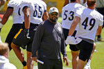 Pittsburgh Steelers head coach Mike Tomlin, center, works during the team's NFL minicamp football practice in Pittsburgh, Thursday, June 17, 2021. (AP Photo/Gene J. Puskar)