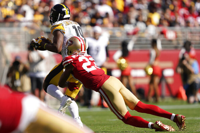 Pittsburgh Steelers wide receiver JuJu Smith-Schuster (19) runs past San Francisco 49ers cornerback Ahkello Witherspoon (23) to score a touchdown during the second half of an NFL football game in Santa Clara, Calif., Sunday, Sept. 22, 2019. (AP Photo/Tony Avelar)