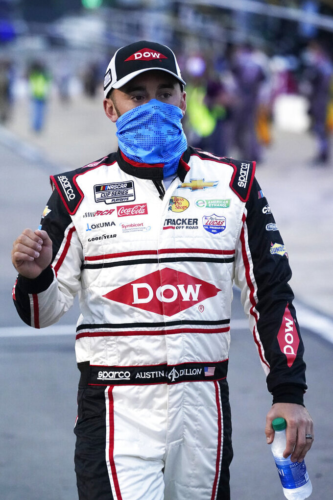 Austin Dillon walks to his car prior to the start of a NASCAR Cup Series auto race Saturday, Sept. 12, 2020, in Richmond, Va. (AP Photo/Steve Helber)