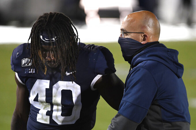 Penn State coach James Franklin consoles linebacker Jesse Luketa (40) following the team's 41-21 loss to Iowa in an NCAA college football game in State College, Pa., Saturday, Nov. 21, 2020. (AP Photo/Barry Reeger)