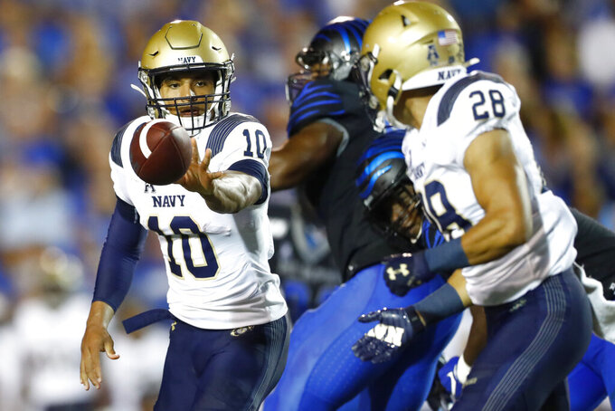 Navy quarterback Malcolm Perry pitches back to running back Keoni-Kordell Makekau during an NCAA college football game against Memphis in Memphis, Tenn., Thursday, Sept. 26, 2019. (Joe Rondone/The Commercial Appeal via AP)