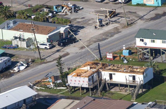 Homes are missing roofs after Hurricane Zeta, Thursday Oct. 29, 2020, in Grand Isle, La., in this aerial photo during Louisiana Gov. John Bel Edwards' tour of stricken areas in the southeastern part of the state. (Bill Feig/The Advocate via AP, Pool)