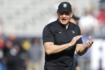 FILE - In this Dec. 22, 2018, file photo, Army head coach Jeff Monken watches as his team warms up before they play Houston in the Armed Forces Bowl NCAA college football game, in Fort Worth, Texas. Army is coming off a year like no other in the storied history of the football program. Coach Monken is ready for an encore. (AP Photo/Jim Cowsert, File)