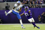 Detroit Lions wide receiver Marvin Jones catches a pass ahead of Minnesota Vikings cornerback Mike Hughes, right, during the first half of an NFL football game, Sunday, Dec. 8, 2019, in Minneapolis. (AP Photo/Andy Clayton-King)
