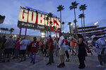 Fans arrive at Raymond James Stadium before an NFL football game between the Tampa Bay Buccaneers and the Dallas Cowboys Thursday, Sept. 9, 2021, in Tampa, Fla. (AP Photo/Chris O'Meara)