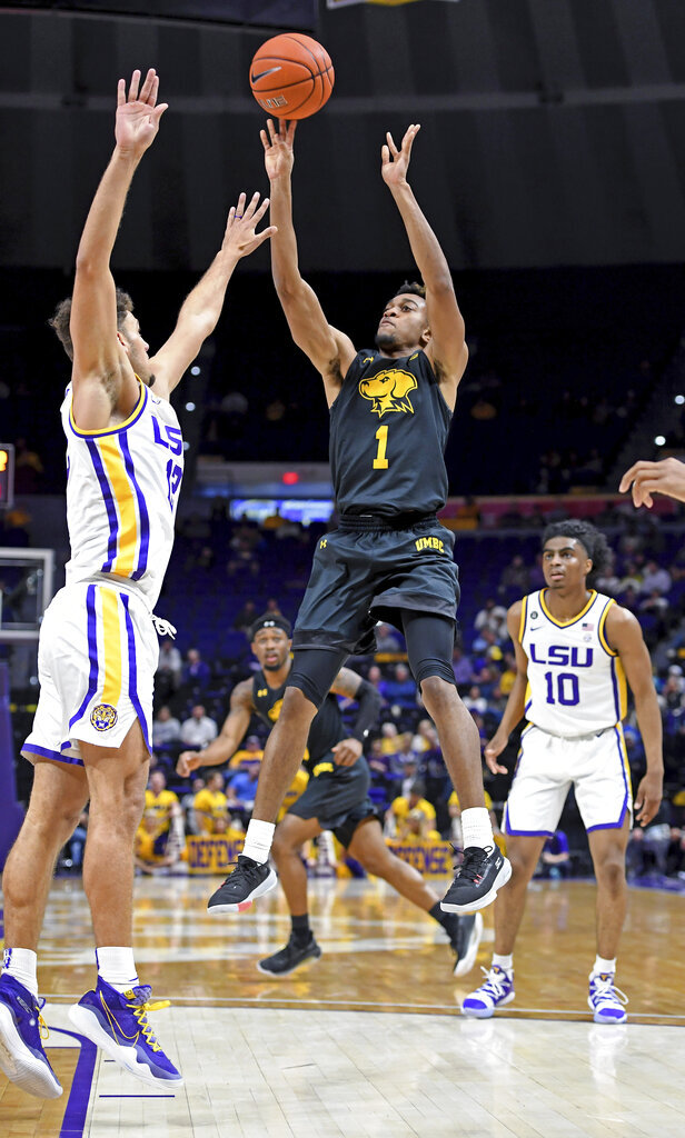 UMBC guard L.J. Owens (1) shoots over the outstretched hands of LSU guard Marshall Graves (12) during the second half of an NCAA college basketball game Tuesday, Nov. 19, 2019, in Baton Rouge, La. LSU won 77-50. (AP Photo/Bill Feig)