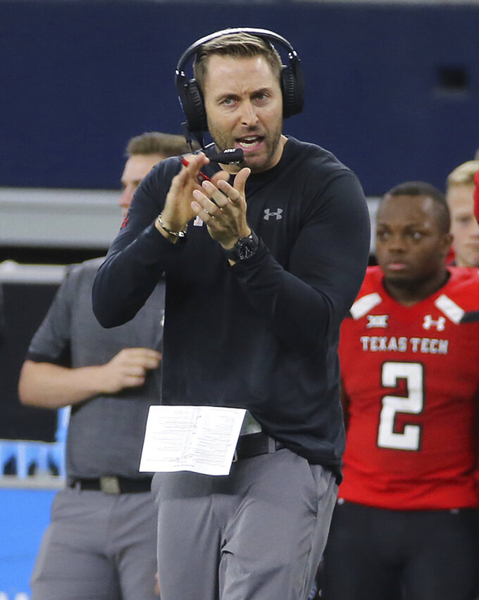 Texas Tech head coach Kliff Kingsbury encourages his players in the second half of an NCAA college football game against Baylor, Saturday, Nov 24, 20178, in Arlington, Texas. (Jerry Larson/Waco Tribune-Herald via AP)