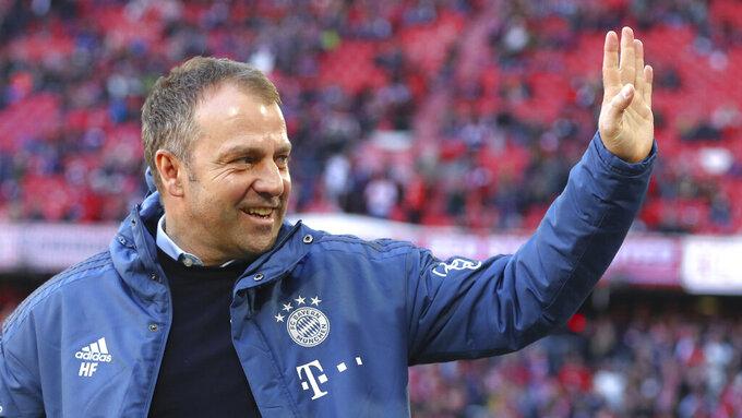 Bayern's interim head coach Hans-Dieter Flick arrives before the German Bundesliga soccer match between FC Bayern Munich and FC Augsburg in Munich, Germany, Sunday, March 8, 2020. (AP Photo/Matthias Schrader)