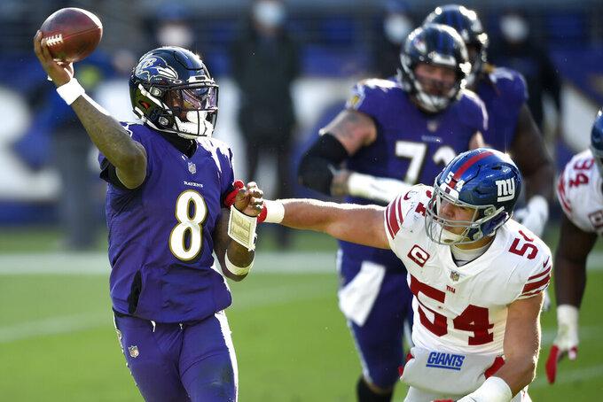 Baltimore Ravens quarterback Lamar Jackson (8) looks to throw a pass as New York Giants inside linebacker Blake Martinez (54) applies pressure during the first half of an NFL football game, Sunday, Dec. 27, 2020, in Baltimore. (AP Photo/Gail Burton)