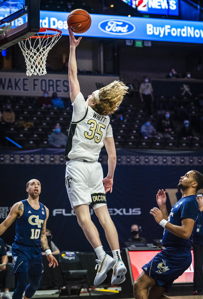 Wake Forest guard Carter Whitt (35) releases a shot during the team's NCAA college basketball game against Georgia Tech on Friday, March 5, 2021, in Winston-Salem, N.C. (Andrew Dye/The Winston-Salem Journal via AP)