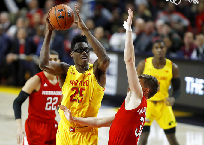 Maryland forward Jalen Smith (25) goes up for a shot against Nebraska guard Thorir Thorbjarnarson (34) during the first half of an NCAA college basketball game, Tuesday, Feb. 11, 2020, in College Park, Md. (AP Photo/Julio Cortez)