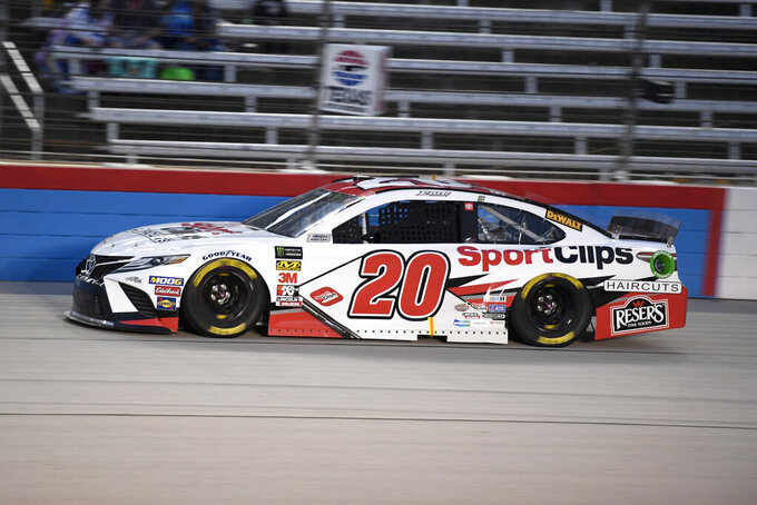Erik Jones heads into the front stretch during qualifying for the NASCAR Cup Series auto race at Texas Motor Speedway in Fort Worth, Texas, Saturday, Nov. 2, 2019. Jones qualified for Sunday's race in the second spot, behind pole-sitter Kevin Harvick. (AP Photo/Larry Papke)