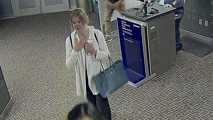 In this image made from a June 2019 Salt Lake City International Airport video provided by the Salt Lake City Police Department shows Mackenzie Lueck, a missing University of Utah student at the airport in Salt Lake City. Police are serving search warrants and hunting for any clues about the mysterious disappearance of Lueck, including basic details about a person she met when she was last seen. (Salt Lake City Police Department via AP)