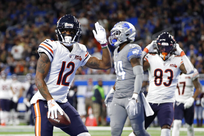 Chicago Bears wide receiver Allen Robinson (12) signals after scoring a touchdown during the first half of an NFL football game against the Detroit Lions, Thursday, Nov. 28, 2019, in Detroit. (AP Photo/Rick Osentoski)