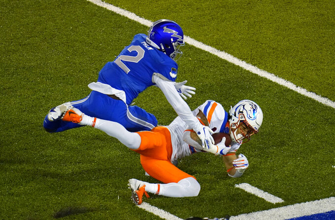 Boise State wide receiver Khalil Shakir, front, pulls in a pass as Air Force cornerback Elisha Palm defends during the second half of an NCAA college football game Saturday, Oct. 31, 2020, at Air Force Academy, Colo. (AP Photo/David Zalubowski)