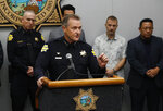 Fresno Police Chief Andrew Hall addresses the media as community leaders and personnel stand behind him about a shooting at a house party which involved multiple fatalities and injuries in Fresno, Calif., Monday, Nov. 18, 2019. (AP Photo/Gary Kazanjian)
