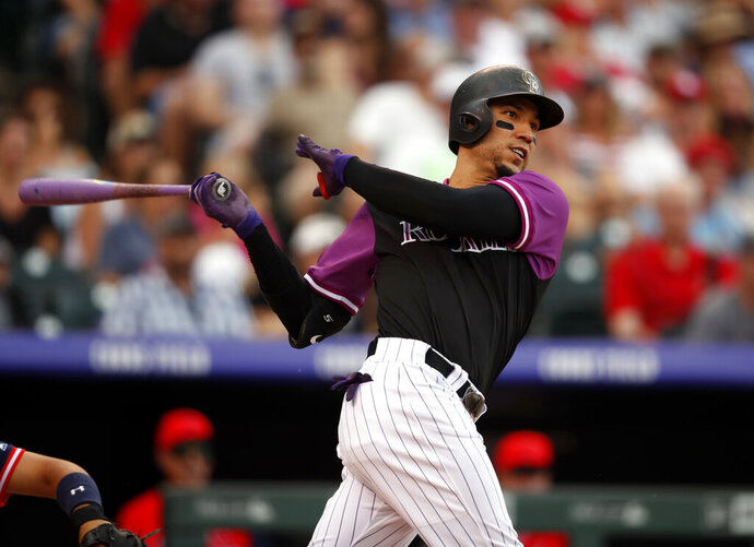 FLE - In this Aug. 26, 2018, file photo, Colorado Rockies right fielder Carlos Gonzalez bats in the eighth inning of a baseball game in Denver. The free-agent outfielder a minor league contract with the Cleveland Indians. If he makes Cleveland's 40-man roster, he will get a $2 million contract in the majors, and can earn $1 million in performance bonuses. (AP Photo/David Zalubowski, File)