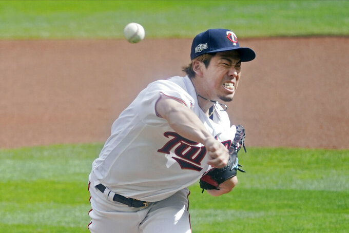 FILE - Minnesota Twins pitcher Kenta Maeda of Japan throws against the Houston Astros in the first inning of an American League playoff baseball game in Minneapolis, in this Tuesday, Sept 29, 2020, file photo. Maeda's first season in Minnesota, albeit abbreviated by the pandemic, was a runaway success. The Japanese right-hander who has averaged 120 innings over the past four years, will have his durability tested in 2021. (AP Photo/Jim Mone, File)