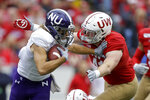 Wisconsin linebacker Noah Burks (41) tackles Northwestern wide receiver Riley Lees (19) during the first half of an NCAA college football game Saturday, Sept. 28, 2019, in Madison, Wis. (AP Photo/Andy Manis)