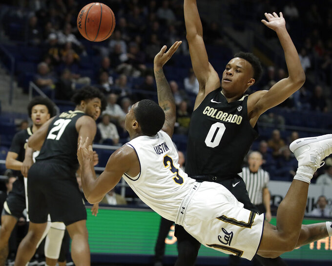 California's Paris Austin (3) passes the ball away from Colorado's Shane Gatling (0) in the first half of an NCAA college basketball game Thursday, Jan. 24, 2019, in Berkeley, Calif. (AP Photo/Ben Margot)