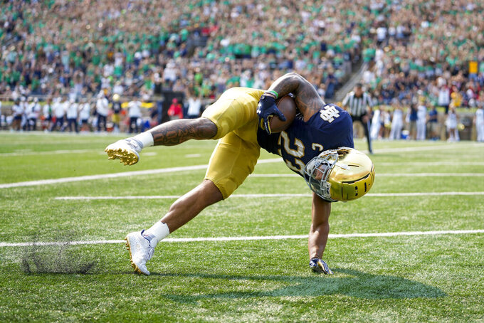 Notre Dame running back Kyren Williams (23) stumbles after scoring a touchdown against Toledo during an NCAA college football game in South Bend, Ind., Saturday, Sept. 11, 2021. (AP Photo/AJ Mast)