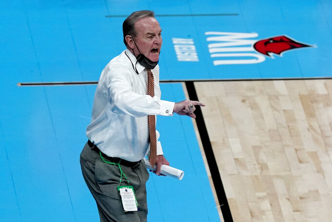 Texas head coach Vic Schaefer talks to his players during the first half of a college basketball gameagainst UCLA in the second round of the women's NCAA tournament at the Alamodome in San Antonio, Wednesday, March 24, 2021. (AP Photo/Charlie Riedel)