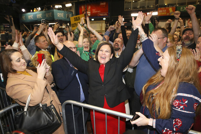 Sinn Fein leader Mary Lou McDonald celebrates with supporters after topping the poll in Dublin central at the RDS count centre in Dublin, Ireland, Sunday, Feb. 9, 2020. (AP Photo/Peter Morrison)