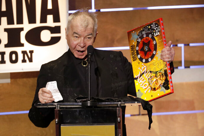 "FILE - This Sept. 11, 2019 file photo shows John Prine accepting the Album of the Year award at the Americana Honors & Awards show in Nashville, Tenn. The Recording Academy has released a new recording of John Prine's ""Angel From Montgomery"" with proceeds going to support the MusiCares COVID-19 Relief Fund. Prine died in April at age 73 from complications associated with the new coronavirus. (AP Photo/Wade Payne, File)"