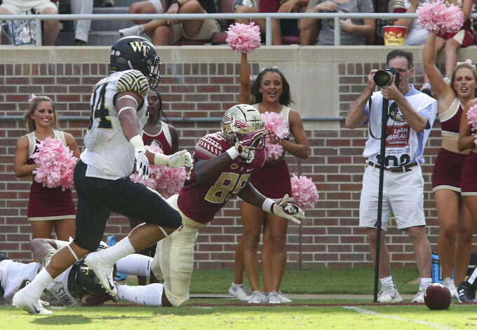 Florida State's Keith Gavin has the ball stripped by Wake Forest's Justin Strnad as Demetrius Kemp moves to recover the ball in the end zone in the second quarter of an NCAA college football game, Saturday, Oct. 20, 2018 in Tallahassee, Fla. Florida State won 38-17. (AP Photo/Steve Cannon)