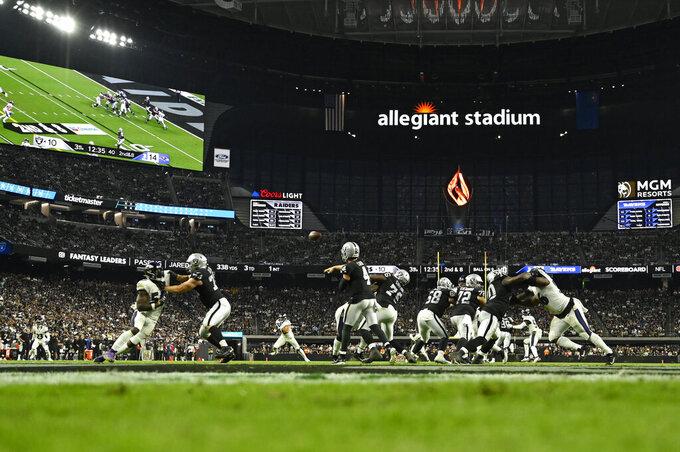 Las Vegas Raiders quarterback Derek Carr (4) throws the ball against the Baltimore Ravens during the second half of an NFL football game, Monday, Sept. 13, 2021, in Las Vegas. (AP Photo/David Becker)