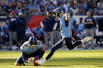 FILE - Tennessee Titans kicker Cody Parkey kicks a 45-yard field goal as Brett Kern (6) holds in the first half of an NFL football game against the Los Angeles Chargers, Sunday, Oct. 20, 2019, in Nashville, Tenn. The Cleveland Browns are replacing kicker Austin Seibert after he missed an extra point and field goal in Sunday's, Sept. 13, 2020, opener, a person familiar with the decision told the Associated Press. Seibert, who clanged his extra point off the left upright and pushed a 41-yard field-goal try to the right, will be replaced by Cody Parkey, said the person who spoke on condition of anonymity because the team has not made the move official.(AP Photo/Mark Zaleski, File)