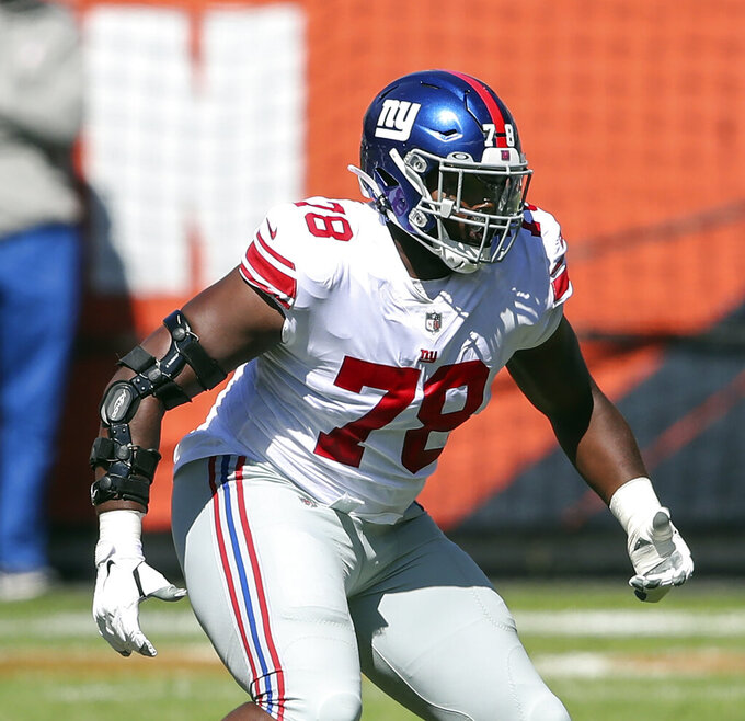 FILE - In this Sunday, Sept. 20, 2020, file photo, New York Giants offensive tackle Andrew Thomas (78) looks to block against the Chicago Bears during the first half of an NFL football game in Chicago. Thomas saw some of the NFL's top passer rushers in his first two games and the rookie left tackle didn't disappoint the Giants. (AP Photo/Kamil Krzaczynski, File)