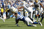 Los Angeles Chargers running back Austin Ekeler (30) scores the winning touchdown during overtime in an NFL football game against the Indianapolis Colts Sunday, Sept. 8, 2019, in Carson, Calif. (AP Photo/Marcio Jose Sanchez)