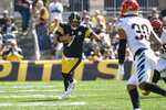 Pittsburgh Steelers quarterback Ben Roethlisberger (7) scrambles as Cincinnati Bengals free safety Jessie Bates (30) closes in during the first half an NFL football game, Sunday, Sept. 26, 2021, in Pittsburgh. (AP Photo/Don Wright)