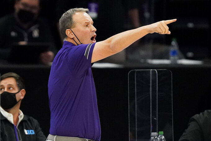 Northwestern head coach Chris Collins points as he talks to his team during the second half of an NCAA college basketball game against Michigan State in Evanston, Ill., Sunday, Dec. 20, 2020. Northwestern won 79-65. (AP Photo/Nam Y. Huh)
