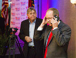 Greg Murphy speaks on the phone with former North Carolina Gov. Pat McCrory after he is announced the winner of the Republican nomination in North Carolina's 3rd Congressional District at Greenville Convention Center in Greenville, N.C., Tuesday, July 9, 2019. (Molly Urbina/The Daily Reflector via AP)