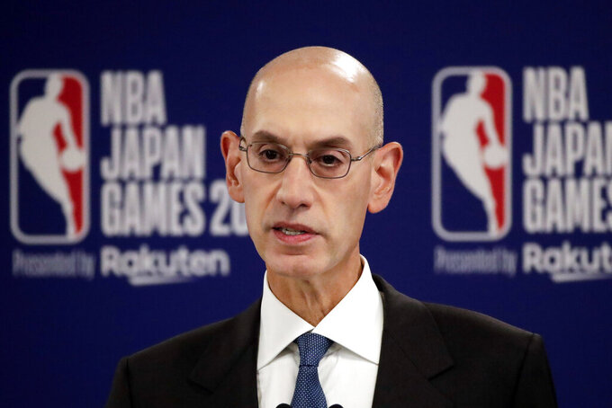 FILE - in this Oct. 8, 2019, file photo, NBA Commissioner Adam Silver speaks at a news conference before an NBA preseason basketball game between the Houston Rockets and the Toronto Raptors in Saitama, near Tokyo. Silver, in an interview with The Associated Press on Friday, Feb. 26, 2021, defended the league's decision to have an All-Star Game in Atlanta on March 7 and said he believes the league can do so safely during a pandemic. (AP Photo/Jae C. Hong, File)