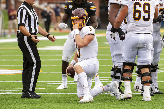 Central Michigan quarterback Jacob Sirmon straightens his face mask after being sacked during the third quarter of an NCAA college football game against Missouri, Saturday, Sept. 4, 2021, in Columbia, Mo. (AP Photo/L.G. Patterson)