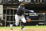 FILE - In this Sept. 26, 2019, file photo, Cleveland Indians' Francisco Lindor (12) bats against the Chicago White Sox during the second inning of a baseball game, in Chicago. Francisco Lindor's status with the Indians has been slightly upgraded. Team president Chris Antonetti said Wednesday, Jan. 8, 2020, that he's more confident that the All-Star shortstop will be in Cleveland's lineup to start the season after the Indians didn't receive a trade proposal over the past few weeks that made sense. (AP Photo/David Banks, File)