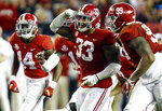 FILE - In this Saturday, Nov. 24, 2018, file photo, Alabama linebacker Anfernee Jennings (33) celebrates with teammates after an interception against Auburn during the second half of an NCAA college football game in Tuscaloosa, Ala. No. 1 Alabama's typically tough defense will be challenged by No. 4 Georgia's offense that enters Saturday's SEC championship game on a roll.  (AP Photo/Butch Dill, FIle)