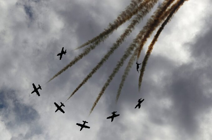 Al Fursan, or the Knights, a UAE Air Force aerobatic display team, perform during the opening day of the International Defence Exhibition & Conference, IDEX, in Abu Dhabi, United Arab Emirates, Sunday, Feb. 21, 2021. (AP Photo/Kamran Jebreili)