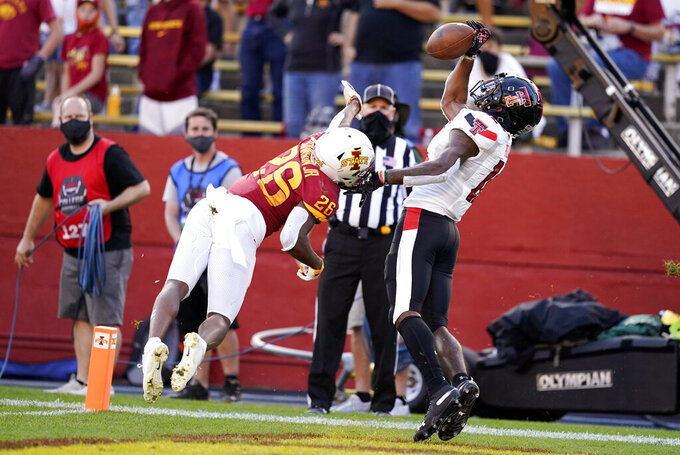 Iowa State defensive back Anthony Johnson Jr. (26) breaks up a pass in the end zone intended for Texas Tech wide receiver Ja'Lynn Polk, right, during the second half of an NCAA college football game, Saturday, Oct. 10, 2020, in Ames, Iowa. Iowa State won 31-15. (AP Photo/Charlie Neibergall)