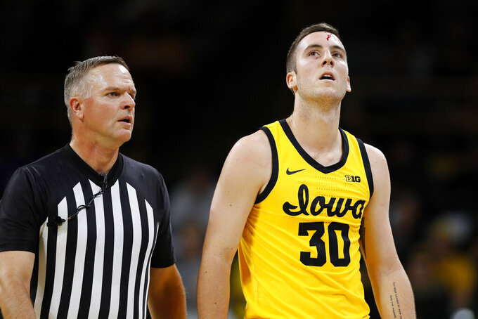 Iowa guard Connor McCaffery (30) walks to the bench after being injured during the first half of an NCAA college basketball game against DePaul, Monday, Nov. 11, 2019, in Iowa City, Iowa.(AP Photo/Charlie Neibergall)