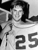 FILE - In this Sept. 27, 1969, file photo, New York Mets pitcher Tom Seaver holds up a No. 25 Mets' uniform after winning his 25th victory of the year against the Philadelphia Phillies in Philadelphia. Seaver has been diagnosed with dementia and has retired from public life. The family of the 74-year-old made the announcement Thursday, March 7, 2019, through the Hall and said Seaver will continue to work in the vineyard at his home in California. (AP Photo, File)