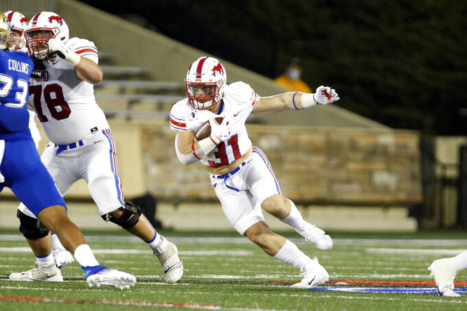 SMU running back Tyler Lavine (31) runs against Tulsa during the first half of an NCAA college football game in Tulsa, Okla., Saturday, Nov. 14, 2020. (AP Photo/Joey Johnson)