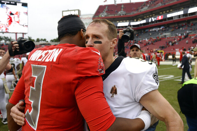 New Orleans Saints quarterback Drew Brees hugs Tampa Bay Buccaneers quarterback Jameis Winston (3) after an NFL football game Sunday, Nov. 17, 2019, in Tampa, Fla. (AP Photo/Jason Behnken)