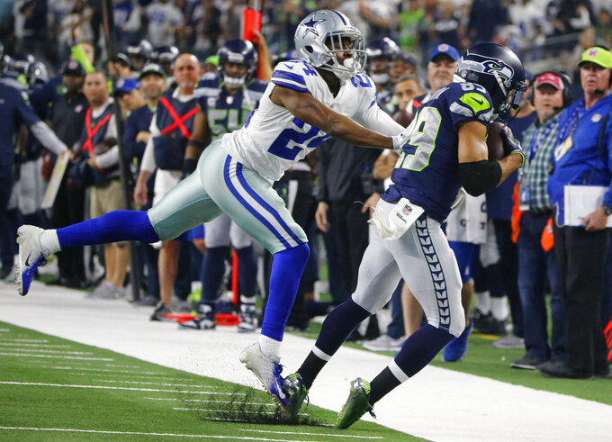 Dallas Cowboys cornerback Chidobe Awuzie (24) defends as Seattle Seahawks wide receiver Doug Baldwin (89) catches a pass during the second half of the NFC wild-card NFL football game in Arlington, Texas, Saturday, Jan. 5, 2019. (AP Photo/Michael Ainsworth)