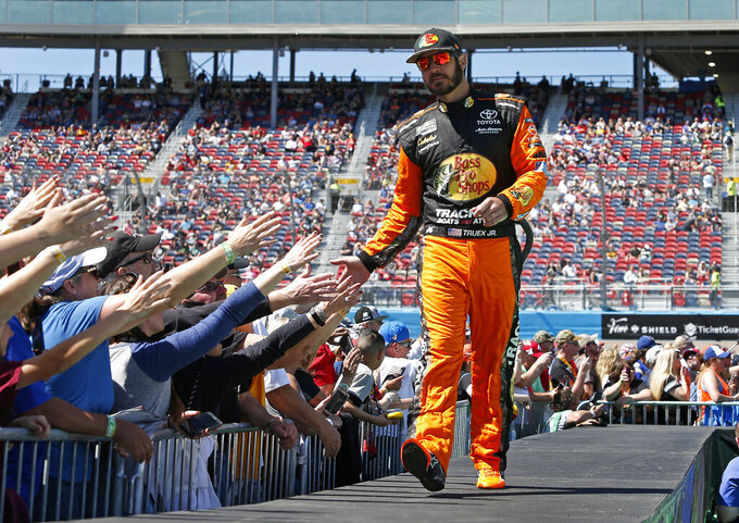 Martin Truex Jr. is greeted by fans during driver introductions prior to the start of the NASCAR Cup Series auto race at ISM Raceway, Sunday, March 10, 2019, in Avondale, Ariz. (AP Photo/Ralph Freso)